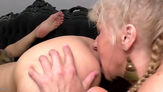 Lusty lesbians are fucking on the black bed