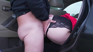 Cute mature is sucking two hard boners