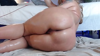 Good-looking busty mature rides on a sex toy