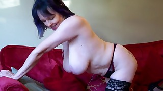 Soloing MILF shows off her sexy lingerie