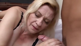 Lusty blonde mature fucked by two horny men