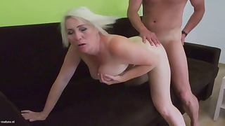 Good-looking mature blonde feels a big dick