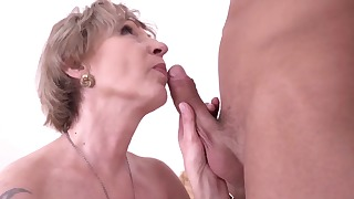 Passionate busty mature feels a big dick